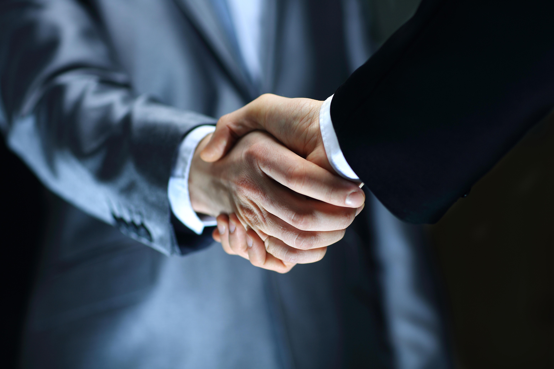 bigstock-Handshake-Hand-holding-on-bl-43772743